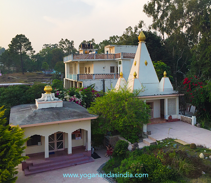 Located in the Himalayan foothills at 1500 m altitude and 25 km from Babaji's cave. Meditation hall on the left, Radha-Krishna temple on the right. In the rear is the building where medical services are offered. Two eye-camps and two medical camps each year provide free care for thousands.