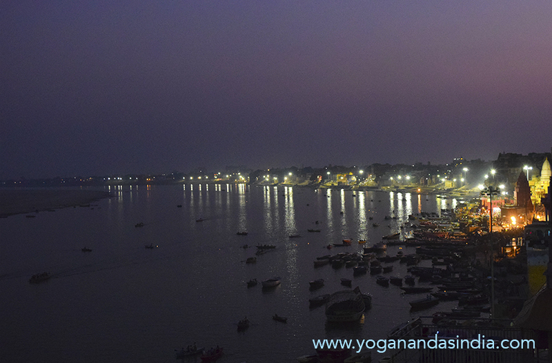 View of the banks of the magnificent, ancient, holy Varanasi on the sacred Ganges, looking upstream to the south. It is little known that Yogananda's guru, Sri Yukteswar, also lived for several months each year in Varanasi where he rented rooms. Here he created his Pranab Ashram hermitage and is where his mother lived.