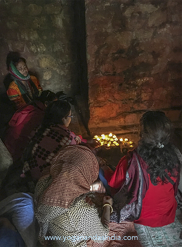 Devotees make ceremonial devotional offerings while visiting the cave.