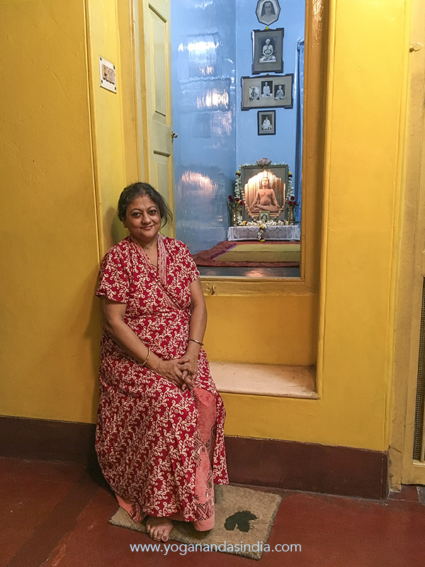 Sarita's husband, Somnath Ghosh, is Sananda Lal Ghosh's (Yogananda's young brother) grandson. Sarita is sitting at the doorstep of Yogananda's attic meditation room.