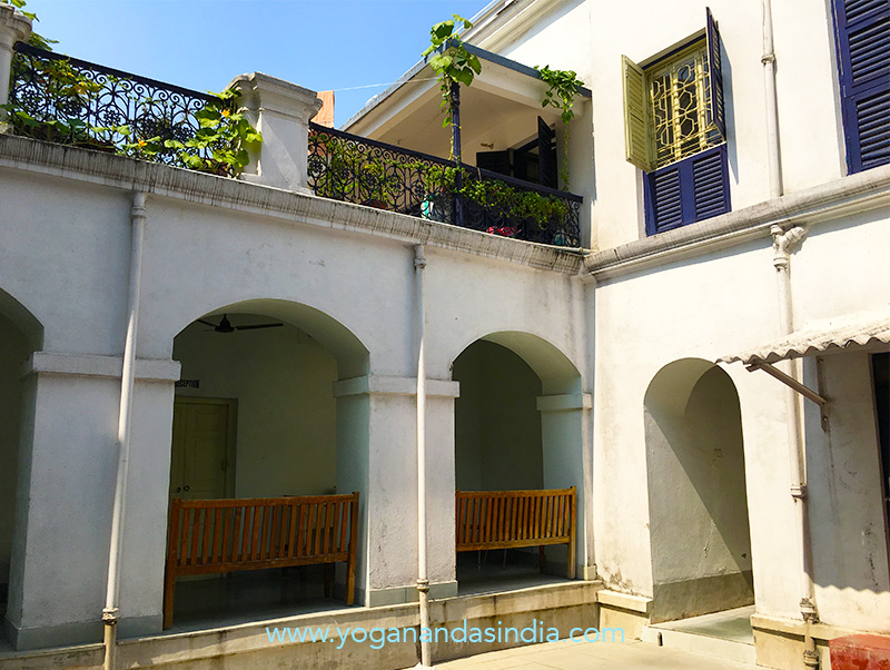 "The courtyard in the center of Uncle Sarada's home. Yogananda's room is through the doorway on the far right. This is where the scene with Sri Yukteswar was filmed in the movie ""Awake."" He was seen walking on the balcony in the upper left."