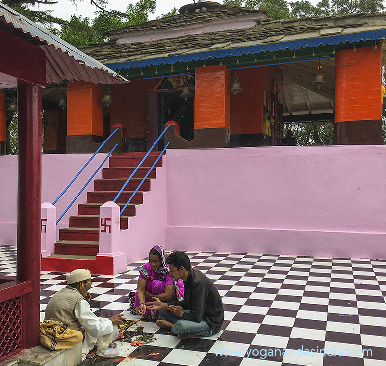 Outside, in the adjacent courtyard, a priest chants continuously in sanskrit, verses from a small well worn book, a Hindu Scripture. He only breaks his chanting routine when pilgrims sit with him for a blessing ceremony.
