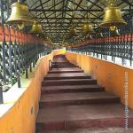 The ancient, sacred and highly spiritually charged Dunagiri Temple dedicated to the worship of Shakti, Divine Mother's principle, is believed by many to be a place Lahiri Mahasaya visited while he was staying in the area for his work, and that he and Babaji Maharaj met there. The way from the road to the temple is a covered staircase of some 500 steps which winds its way nearly a kilometer up to the top of the ridge. The bells are hung the entire way.