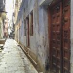Madan Pura Lane leading from Lahiri Mahasaya's home on the right to Chausatti ghat through the narrow lanes of the ancient city's Bengali section.