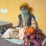 A few colorful characters are encountered along the way up to the temple, including begging sadhus offering to exchange some rudraksha seeds for a few rupees, and some with flowers for offerings to Divine Mother in the temple.