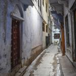 The narrow Madan Pura Lane in the Bengali section of Varanasi, where Lahiri Mahasaya was living. The door of his house is seen on the left. This side of the lane leads to the Muslim market area.