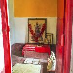 Sri Yukteswarji's special place for meditation. It is a 5' X 7' room with a small window on the garden. It also possibly served as his puja (Hindu worship rituals) room. A photo of the Goddess Kali and a photo of Lahiri Mahasaya are presiding on a little altar.