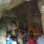 Inside of the cave pilgrims sit in meditation. Entrance is by permission of YSS Dwarahat ashram.
